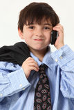 Adorable Boy in Baggy Suit with Cellphone Stock Photos