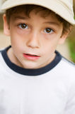 Adorable boy with big brown eyes. Closeup of little boy with big brown eyes looking up into the camera Stock Photography