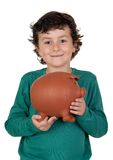 Adorable boy with big piggy bank. Isolated over white Royalty Free Stock Images