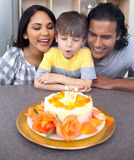 Adorable boy blowing out candles for his birthday Royalty Free Stock Photography