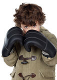 Adorable boy with boxing gloves Royalty Free Stock Photography