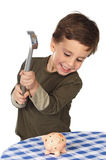 Adorable boy breaking the money box Stock Images