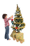 Adorable boy in Christmas. A small boy to adorning his arbol of Christmas so that santa claus comes with the gifts Stock Photography