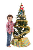 Adorable boy in Christmas. A small boy to adorning his arbol of Christmas so that santa claus comes with the gifts Stock Photo
