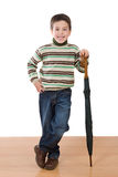 Adorable boy with close umbrellas Royalty Free Stock Image