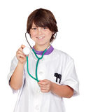 Adorable boy with clothes of doctor isolated on wh Stock Photos