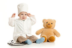 Adorable boy with clothes of doctor and teddy Stock Photo