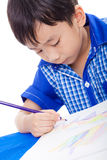 Adorable boy drawing picture Royalty Free Stock Photography