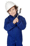 Adorable boy dressed worker in a hammer and a helmet Royalty Free Stock Images