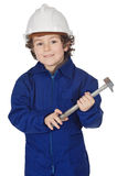 Adorable boy dressed worker in a hammer and a helmet Royalty Free Stock Image