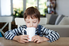 Adorable boy drinking Stock Photo