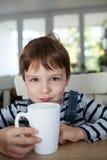 Adorable boy drinking Royalty Free Stock Photos