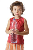 Adorable boy drinking water. Photo of an adorable boy drinking water a over white background Stock Images