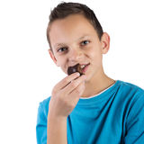 Adorable boy eating cookies Royalty Free Stock Photos