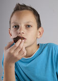 Adorable boy eating cookies. Close up of Adorable boy eating cookies Royalty Free Stock Image