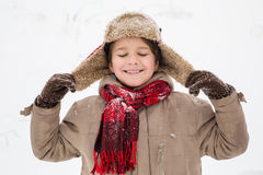 Adorable boy enjoying the winter. Outdoors snow landscape Stock Photo