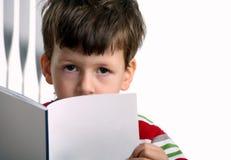 Adorable boy with exercise book Stock Photo