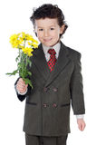 Adorable boy with flowers Royalty Free Stock Photography