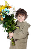 Adorable boy with flowers Royalty Free Stock Image