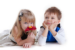 Adorable boy and the girl smelling a flower Stock Photo