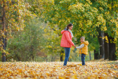 Adorable boy with his mother in autumn park Stock Images