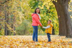 Adorable boy with his mother in autumn park Royalty Free Stock Photo