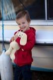 Adorable boy, holding his teddy bear, smiling Stock Photos