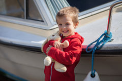 Adorable boy, holding his teddy bear, smiling Royalty Free Stock Photo