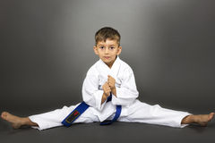Adorable boy in kimono training on the floor Stock Photography