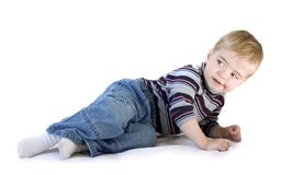 Adorable boy laying down Stock Photo