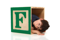 Adorable Boy and the Letter F Royalty Free Stock Photography
