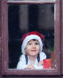 Adorable boy, looking through window, waiting Stock Photography