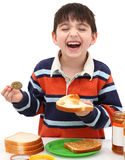 Adorable Boy Making Peanutbutter Sandwich Stock Images