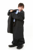 Adorable Boy in Over Sized Suit Stock Photography