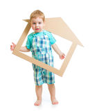 Adorable boy in own cardboard home or room concept Stock Image