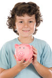 Adorable boy with pink piggy bank Stock Image