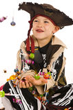 Adorable boy in pirate costume Stock Photos