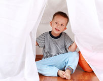 Adorable boy playing Stock Images
