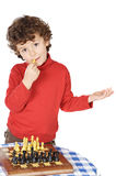 Adorable boy playing the chess Stock Photos