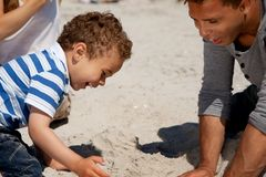 Adorable Boy Plays in the Sand with His Dad Royalty Free Stock Images