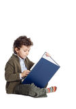 Adorable boy reading a book. Boy learning to read with white bottom Stock Images