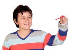 Adorable boy with a red pencil Stock Photos