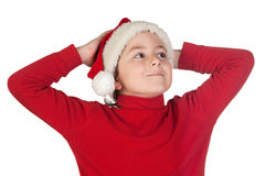 Adorable boy with santa hat Stock Images