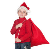 Adorable boy with santa hat Royalty Free Stock Photos