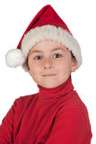 Adorable boy with santa hat Stock Image