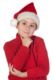 Adorable boy with santa hat thinking Stock Photo
