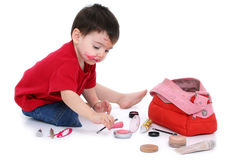 Adorable Boy Sneaks Into Moms Purse And Makes A Mess Royalty Free Stock Photo