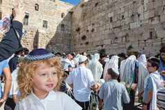 Adorable boy stands at Western Wall of Temple Stock Image
