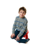 Adorable boy on a stool Stock Photos