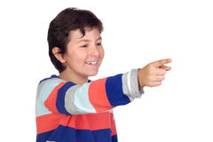 Adorable boy with a striped jersey pointing. Isolated on a over white background Royalty Free Stock Photos